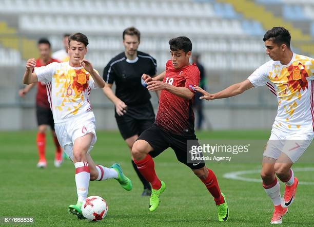 Hasan Adiguzel of Turkey in action against Antonio Blanco of Spain during the Uefa U17 Championship Group A first round match between Turkey and...