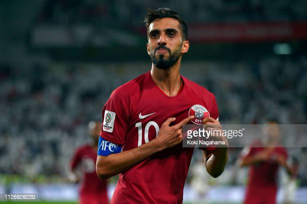 Hasan Al Haydos of Qatar celebrates scoring their third goal during the AFC Asian Cup semi final match between Qatar and United Arab Emirates at...