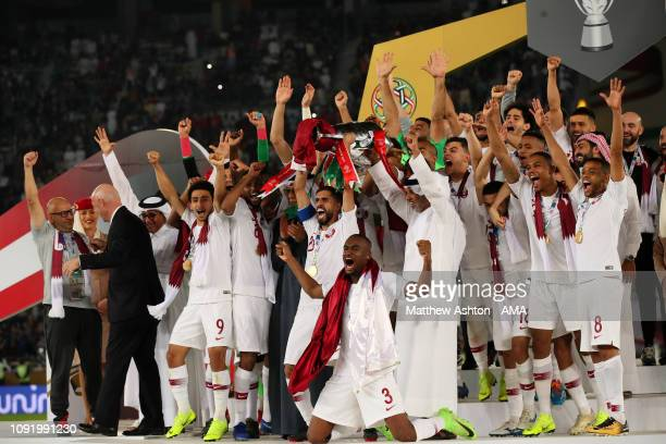 Hasan Al Haydos of Qatar lifts the trophy at the end of the AFC Asian Cup final match between Japan and Qatar at Zayed Sports City Stadium on...