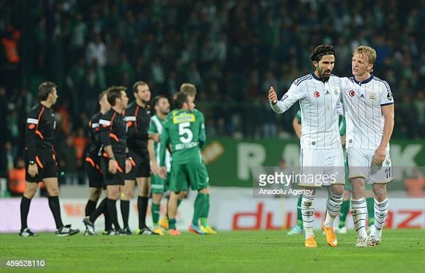 Hasan Ali Kaldirim and Dirk Kuyt of Fenerbahce gesture after the Turkish Spor Toto Super League football match between Bursaspor and Fenerbahce...