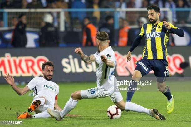 Hasan Ali Kaldirim of Fenerbahce in action against Kanstrup of Buyuksehir Belediye Erzurumspor during Turkish Super Lig week 33 football match...
