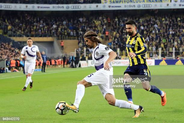 Hasan Ali Kaldirim of Fenerbahce in action against Tiago Pinto of Osmanlispor during the Turkish Super Lig football match between Fenerbahce and...