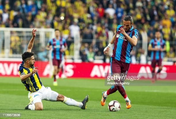 Hasan Ali Kaldirim of Fenerbahce in action against Yusuf Yazici of Trabzonspor during Turkish Super Lig week 30 soccer match between Fenerbahce and...