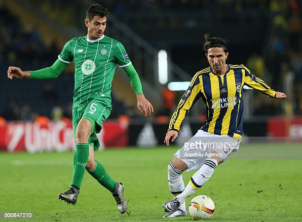 Hasan Ali Kaldirim of Fenerbahce vies for the ball with Nir Bitton of Celtic during the UEFA Europa League Group A soccer match between Fenerbahce SK...