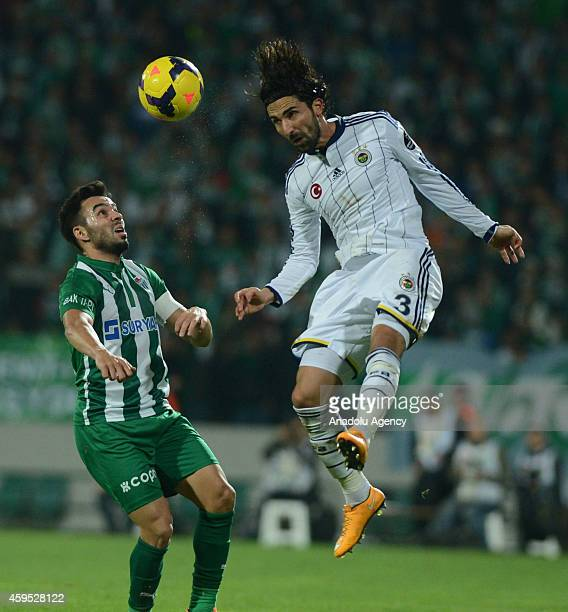 Hasan Ali Kaldirim of Fenerbahce vies with Volkan Sen of Bursaspor during the Turkish Spor Toto Super League football match between Bursaspor and...