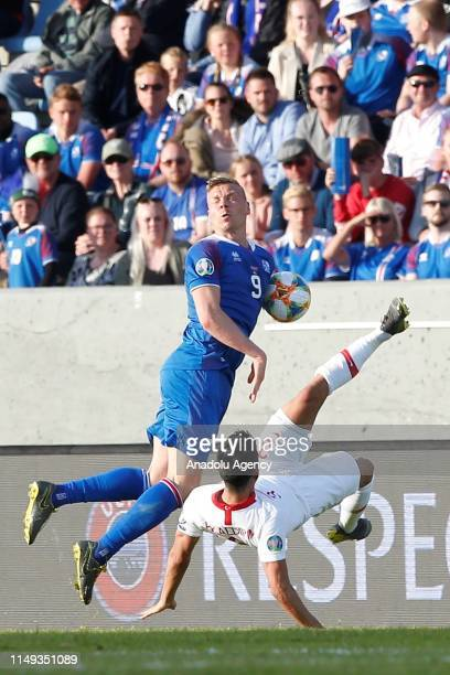 Hasan Ali Kaldirim of Turkey in action against Kolbeinn Sigthorsson of Iceland during UEFA European Qualifying Group H match between Iceland and...