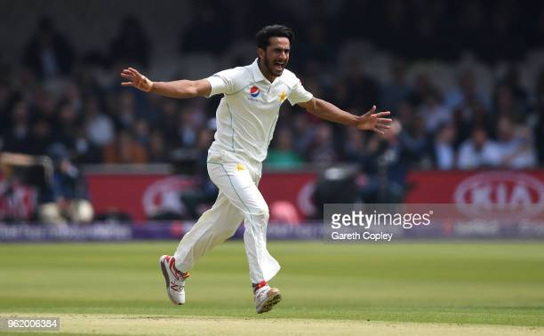 Hasan Ali of Pakistan celebrates dismissing England captain Joe Root during the NatWest 1st Test match between England and Pakistan at Lord's Cricket...