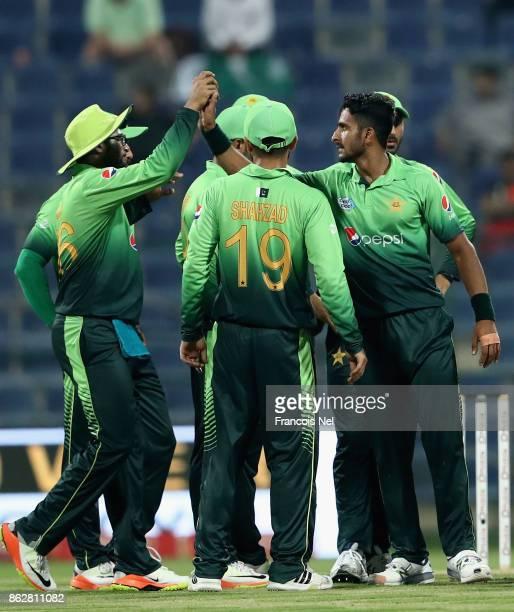 Hasan Ali of Pakistan celebrates with teammates after dismissing Akila Dananjaya of Sri Lanka during the third One Day International match between...