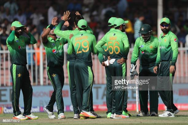 Hasan Ali of Pakistan celebrates with teammates after dismissing Sadeera Samarawickrama of Sri Lanka during the third one day international cricket...