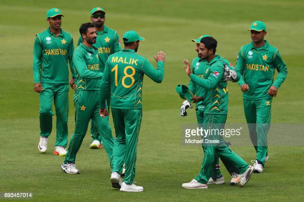 Hasan Ali of Pakistan is congratulated after taking a catch to dismiss Kagiso Raabada of South Africa off the bowling of Junaid Khan during the ICC...