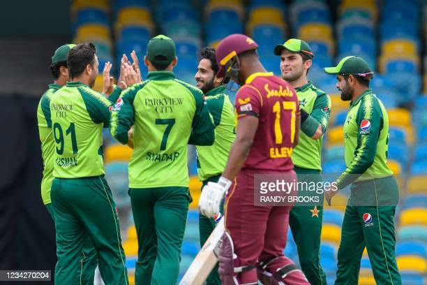 Hasan Ali , Shareen Afridi and Shadab Khan of Pakistan celebrate the dismissal of Evin Lewis of West Indies during the 1st T20I between West Indies...