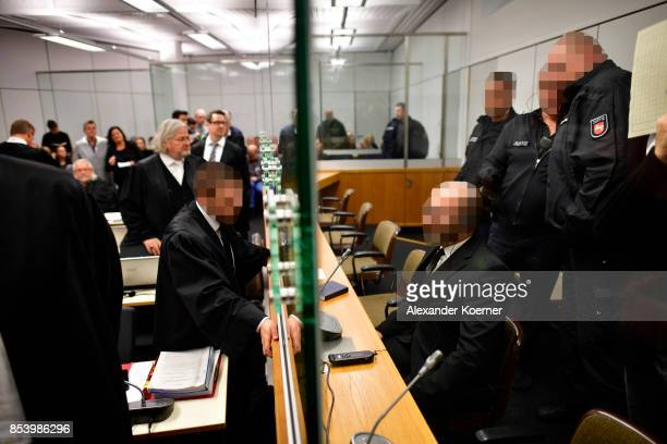 Hasan C arrives for the first day of his trial on terror charges at the Oberlandesgericht Celle courthouse on September 26 2017 in Celle Germany...