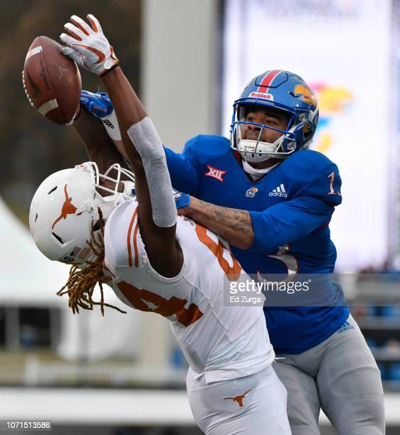 Hasan Defense of the Kansas Jayhawks breaks up a pass intended for wide receiver Lil'Jordan Humphrey of the Texas Longhorns in third quarter at...