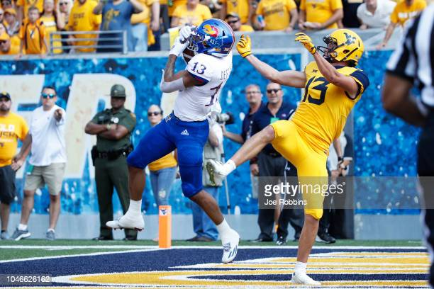Hasan Defense of the Kansas Jayhawks intercepts a pass in the end zone against David Sills V of the West Virginia Mountaineers in the first quarter...