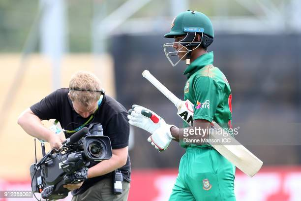 Hasan Mahmud of Bangladesh comes from the field after being dismissed during the ICC U19 Cricket World Cup 5th Playoff match between South Africa and...