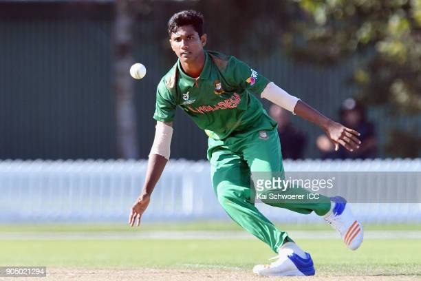 Hasan Mahmud of Bangladesh fields the ball off his own bowling during the ICC U19 Cricket World Cup match between Bangladesh and Canada at Bert...