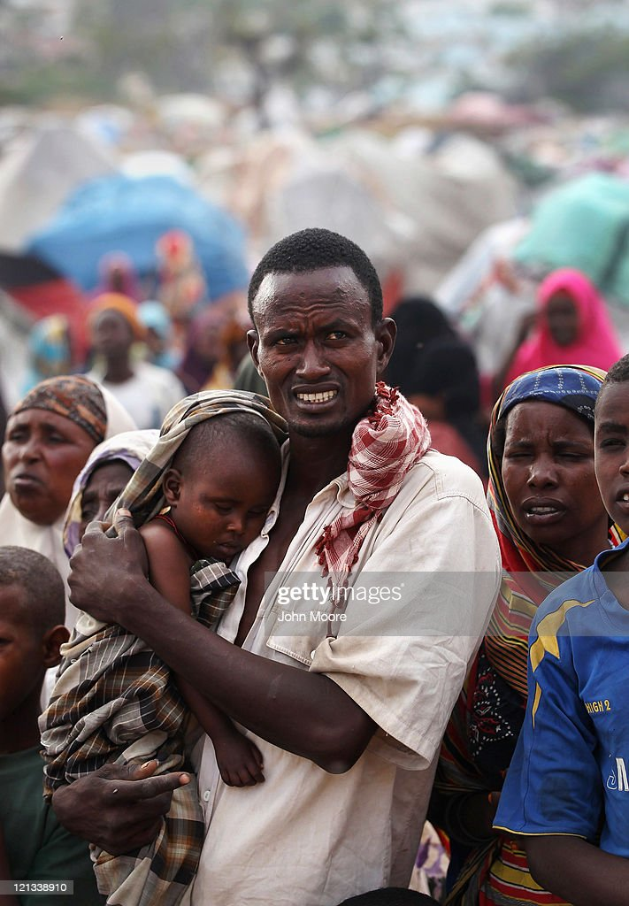 Hasan Mo'alin, 36, holds his son Isho Hassan, 3, at a camp for Somalis displaced by drought and famine on August 18, 2011 in Mogadishu, Somalia. The UN estimates that more than 100,000 people have fled their villages to Mogadishu in the last two months due to the crisis. Some 1.5 million Somalis are estimated displaced nationwide due to drought, famine and war. The UN is investigating reports that thousands of sacks of food aid for famine victims have been stolen and are for sale on the open market.