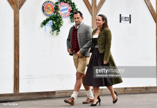 Hasan Salihamidzic and Esther Copado attend the Oktoberfest beer festival at Kaefer Wiesenschaenke tent at Theresienwiese on October 7, 2018 in...