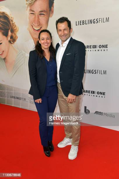 Hasan Salihamidzic and Esther Copado attend the premiere of the film Trautmann at Mathaeser Filmpalast on March 4 2019 in Munich Germany
