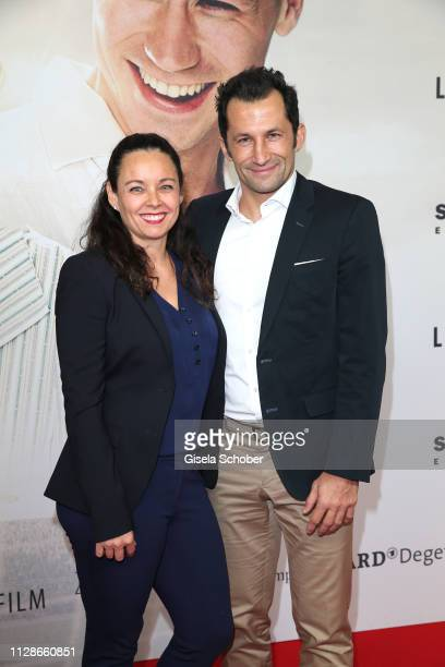 """Hasan Salihamidzic and his wife Esther Salihamidzic during the premiere of the film """"Trautmann"""" at Mathaeser Filmpalast on March 4, 2019 in Munich,..."""