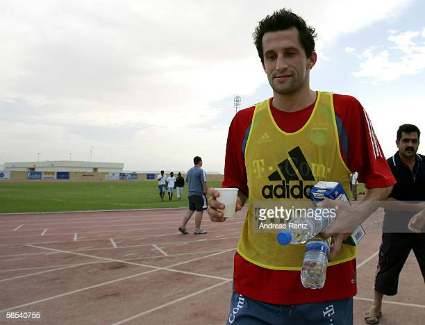 Hasan Salihamidzic leaves the pitch after finishing the morning session during Bayern Munich training camp on January 8 2006 in Dubai United Arab...