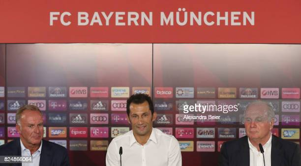 Hasan Salihamidzic new assigned sports director of FC Bayern Muenchen answers journalists' questions next to FC Bayern Muenchen president Uli Hoeness...