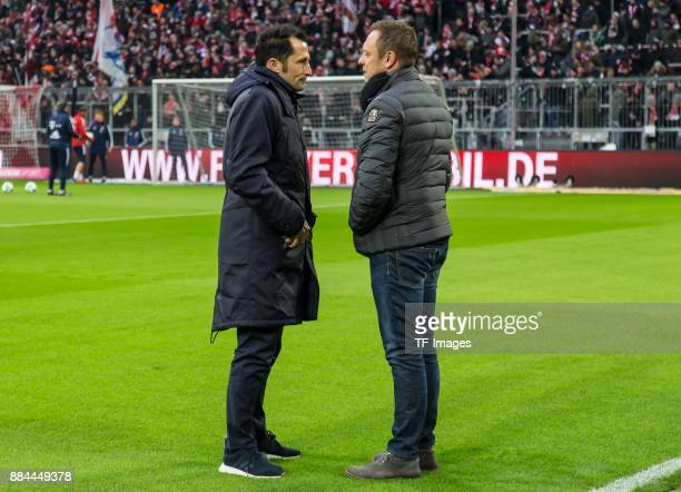 Hasan Salihamidzic of Bayern Muenchen speaks with Head coach Andre Breitenreiter of Hannover prior to the Bundesliga match between FC Bayern Muenchen...