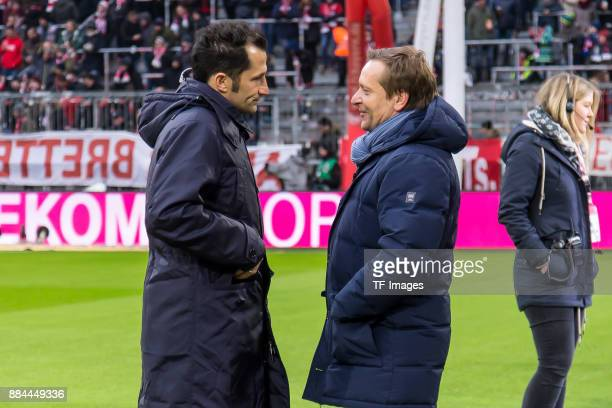 Hasan Salihamidzic of Bayern Muenchen speaks with Horst Heldt of Hannover prior to the Bundesliga match between FC Bayern Muenchen and Hannover 96 at...