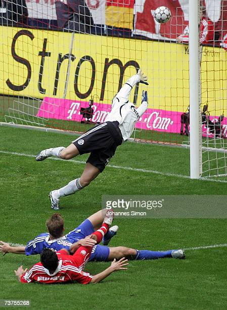 Hasan Salihamidzic of Bayern Munich scores 20 against Schalke goalkeeper Manuel Neuer during the Bundesliga match between FC Bayern Munich and...