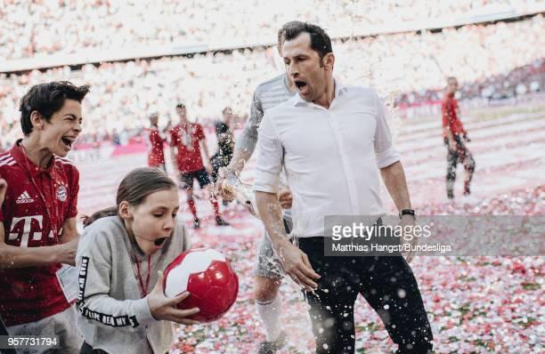 Hasan Salihamidzic, sport director of Muenchen, gets a beer shower by goalkeeper Manuel Neuer of FC Bayern Muenchen after the Bundesliga match...