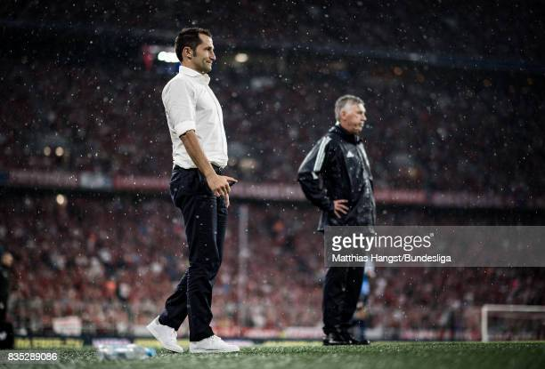 Hasan Salihamidzic Sporting director of Bayern Muenchen and head coach Carlo Ancelotti of FC Bayern Muenchen seen during the Bundesliga match between...