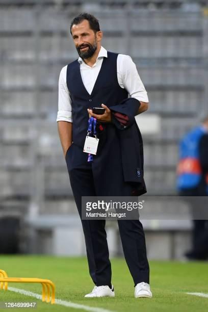 Hasan Salihamidzic, Sporting director of Bayern Munich looks on ahead of the UEFA Champions League round of 16 second leg match between FC Bayern...