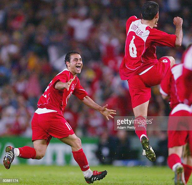 Hasan Sas of Turkey celebrates a goal by Umit Ozat of Turkey during the Australia v Turkey friendly international soccer match as part of the 2006...