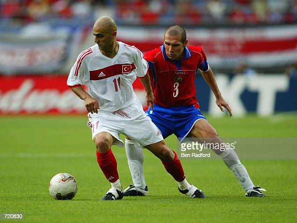 Hasan Sas of Turkey shields the ball from Luis Marin of Costa Rica during the FIFA World Cup Finals 2002 Group C match played at the Incheon Munhak...