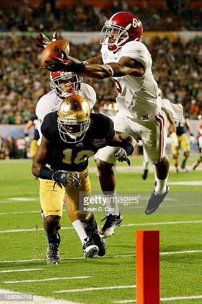 Ha'Sean ClintonDix of the Alabama Crimson Tide intercepts a pass intended for DaVaris Daniels of the Notre Dame Fighting Irish in the third quarter...