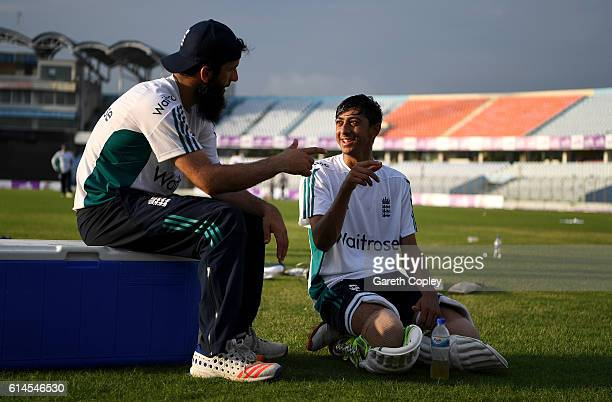 Haseeb Hameed of England speaks with Moeen Ali during a nets session at Zohur Ahmed Chowdhury Stadium on October 14 2016 in Chittagong Bangladesh