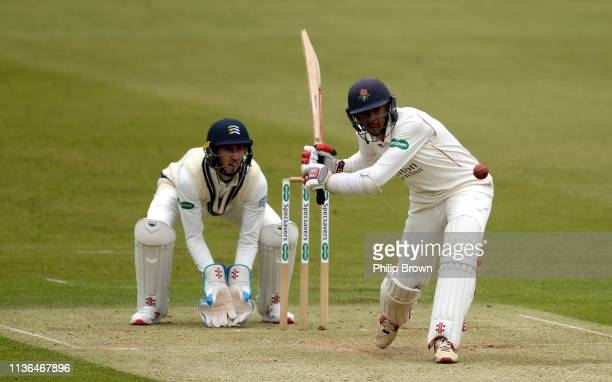 Haseeb Hameed of Lancashire hits out watched by John Simpson of Middlesex during his century during the second day of the County Championship...
