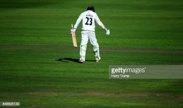Haseeb Hameed of Lancashire walks off after being dismissed during Day Three of the Specsavers County Championship Division One match between...