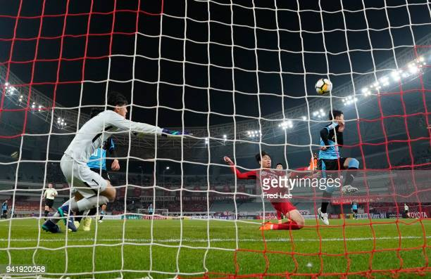Hasegawa Tatsuya of Kawasaki Frontale and Fu Huan of Shanghai SIPG in action during the 2018 AFC Champions League match between Shanghai SIPG and...