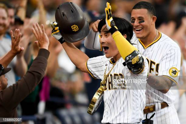 Ha-Seong Kim of the San Diego Padres is congratulated after hitting a two-run home run during the eighth inning of a baseball game against the...