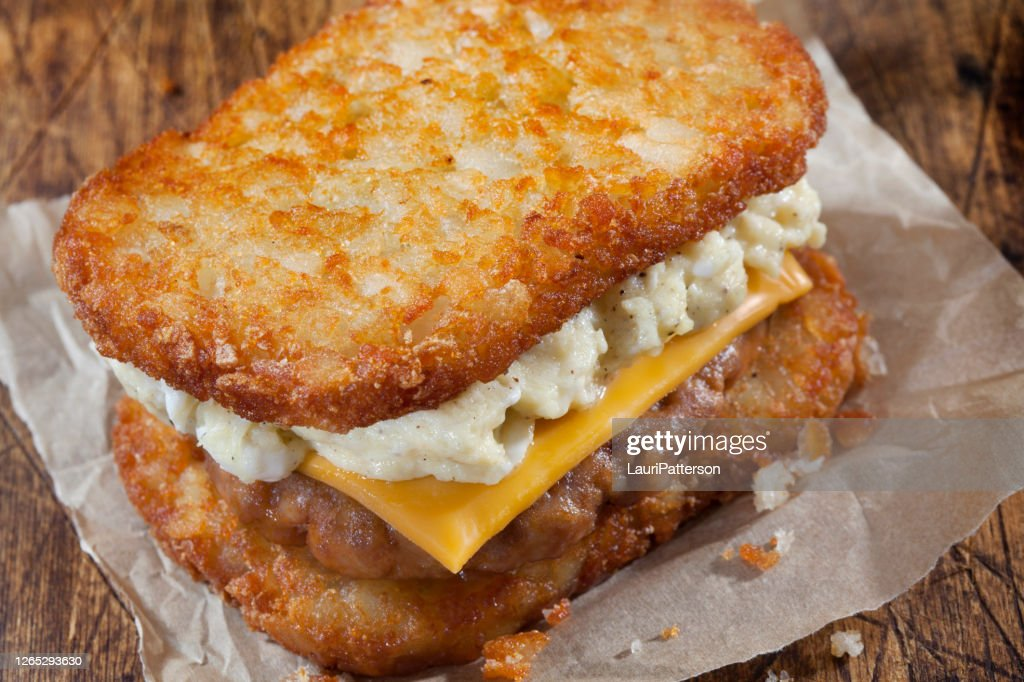 Hash Brown Breakfast Sandwich With Sausage Scrambled Eggs And Cheese High Res Stock Photo Getty Images