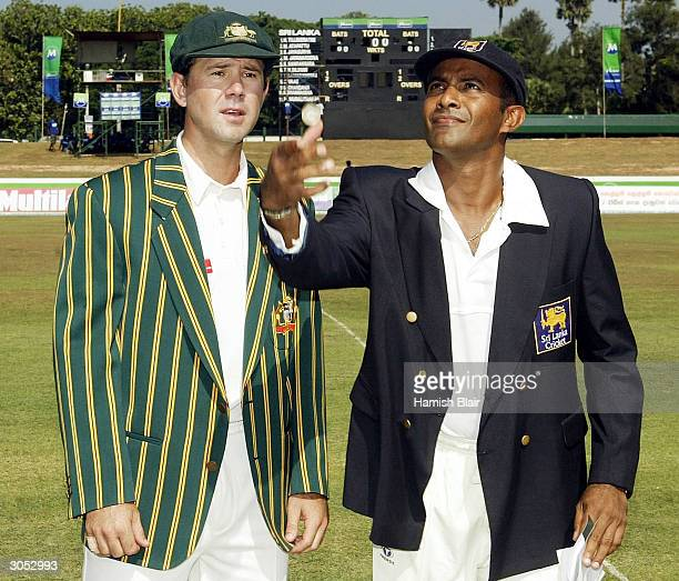 Hashan Tillakaratne captain of Sri Lanka tosses the coin with Ricky Ponting captain of Australia looking on during day one of the First Test between...