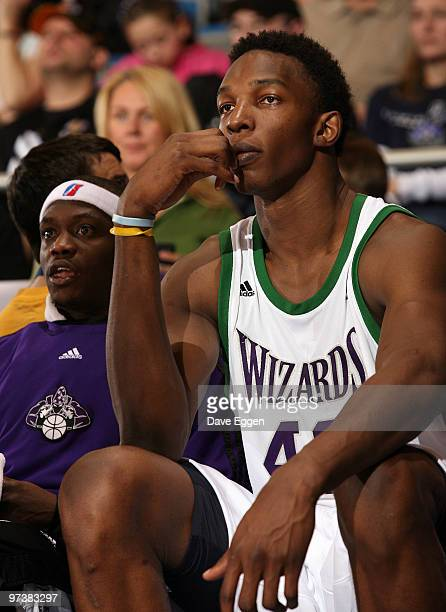 Hasheem Thabeet of the Dakota Wizards watches the game against the Albuquerque Thunderbirds with teammate Maurice Baker in the first half of their...