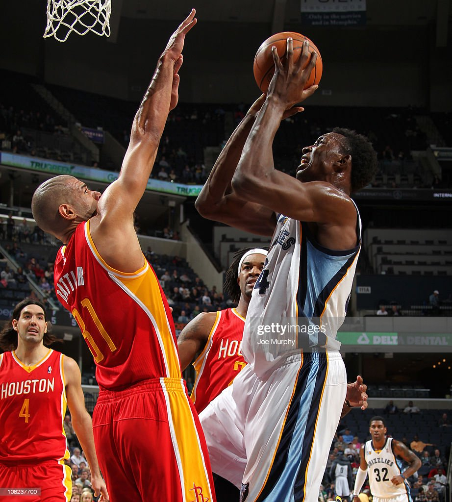 Hasheem Thabeet #34 of the Memphis Grizzlies shoots over Shane Battier #31 of the Houston Rockets on January 21, 2011 at FedExForum in Memphis, Tennessee.