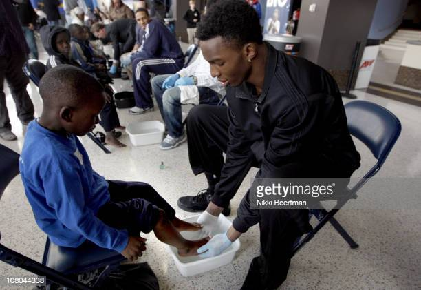 Hasheem Thabeet of the Memphis Grizzlies washes feet during a Samaritan's feet event on January 14, 2011 at FedExForum in Memphis, Tennessee. NOTE TO...