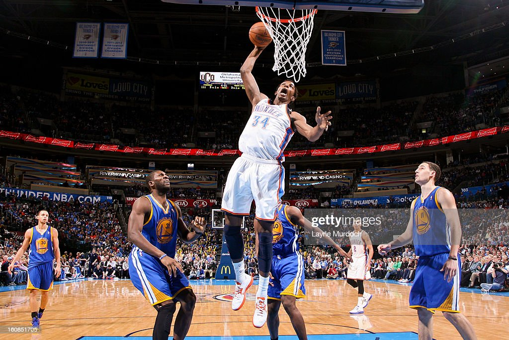 Hasheem Thabeet #34 of the Oklahoma City Thunder dunks against the Golden State Warriors on February 6, 2013 at the Chesapeake Energy Arena in Oklahoma City, Oklahoma.