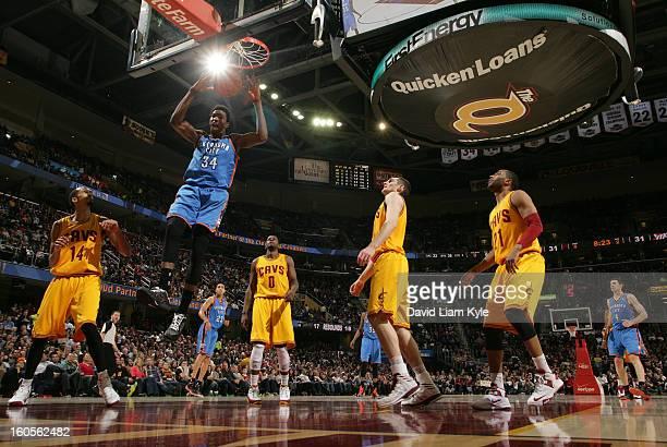 Hasheem Thabeet of the Oklahoma City Thunder dunks the ball while surrounded by Shaun Livingston CJ Miles Tyler Zeller and Wayne Ellington of the...