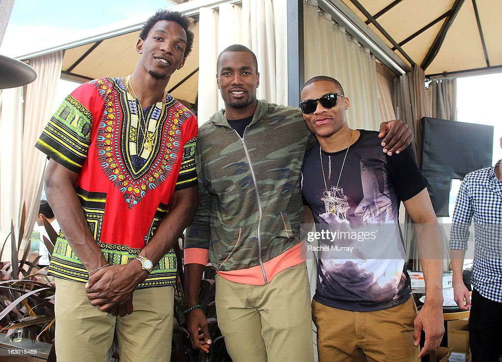 Hasheem Thabeet, Serge Ibaka, and Russell Westbrook attend Flaunt Magazine and Samsung Galaxy celebrate The Plutocracy Issue release hosted by cover Russell Westbrook at Caulfield's Bar and Dining Room at Thompson Hotel on March 2, 2013 in Beverly Hills, California.