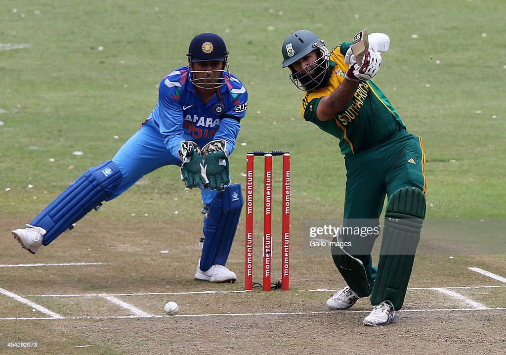 Hashim Alma gets to his 50 runs during the 2nd Momentum ODI match between South Africa and India at Sahara Stadium Kingsmead on December 08, 2013 in Durban, South Africa.