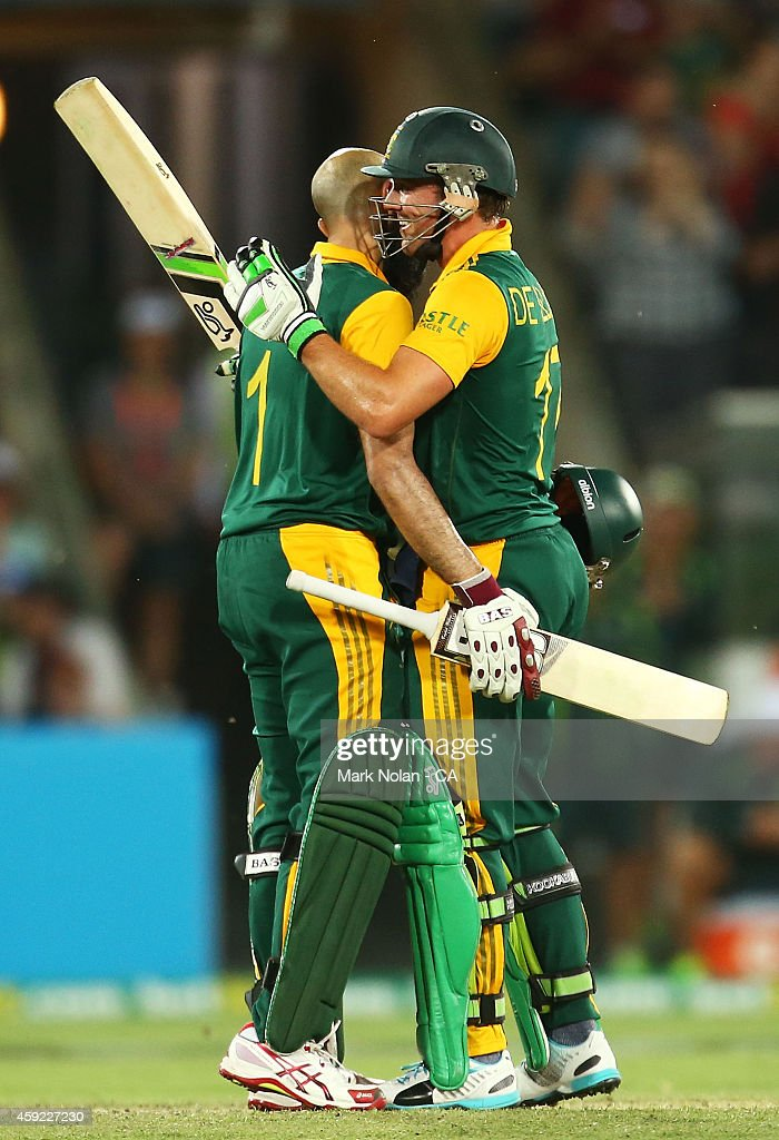 Hashim Amla and AB de Villiers of South Africa embrace after Amla scored a century during game three of the One Day International Series between Australia and South Africa at Manuka Oval on November 19, 2014 in Canberra, Australia.